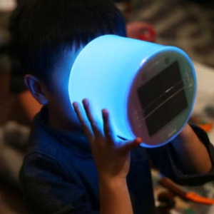 boy holding luci color (blue) solar inflatable light